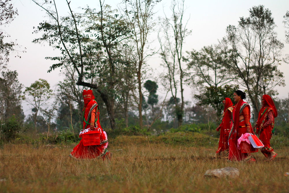 Women in red walking in the filed