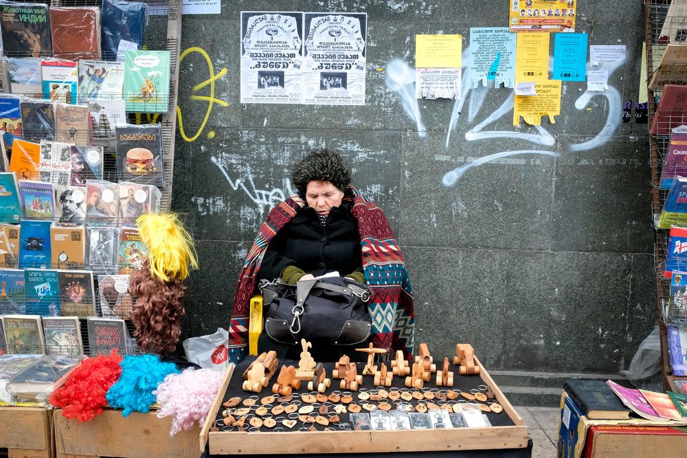 a woman selling souvenirs in the streets of Tbilisi