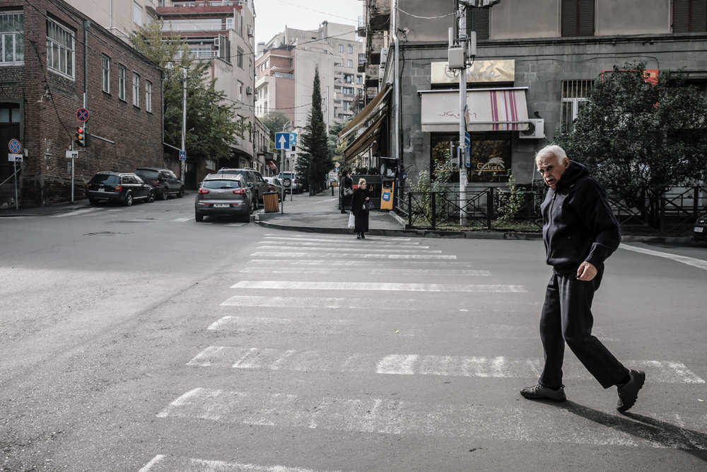 A man crossing a street