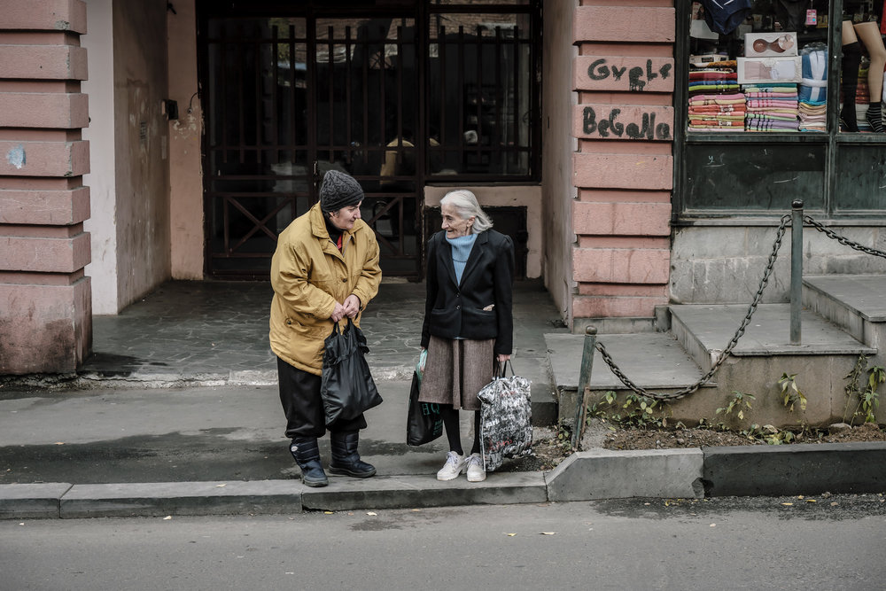 two elderly women talking