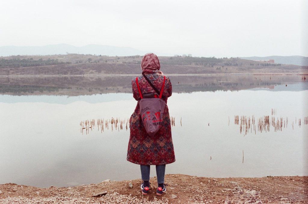colorful beautiful girl looking at the Lisi Lake