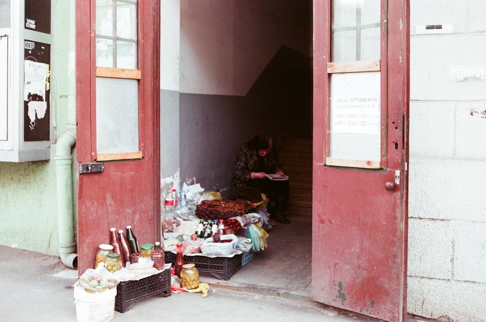 a woman selling food on the street